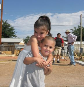children playing during a habitat build day