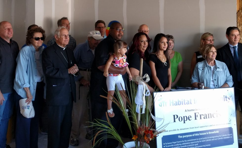 At the Pope Francis House dedication ceremony: Jim Saya, Exec Dir of Lewis University; Irv and Lois Hall; Archbishop Sheehan; Cordova Family; Jerry Ortiz y Pino, NM Senator; Joan Costello, Exec Dir of GAHH; Lori Valdez, Board Pres of GAHH; and Ken Sanchez, City Counselor