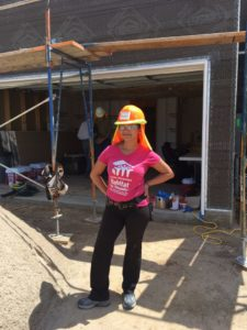 Habitat Homeowner Shade in front of a home on the Mesa del Rio Construction site